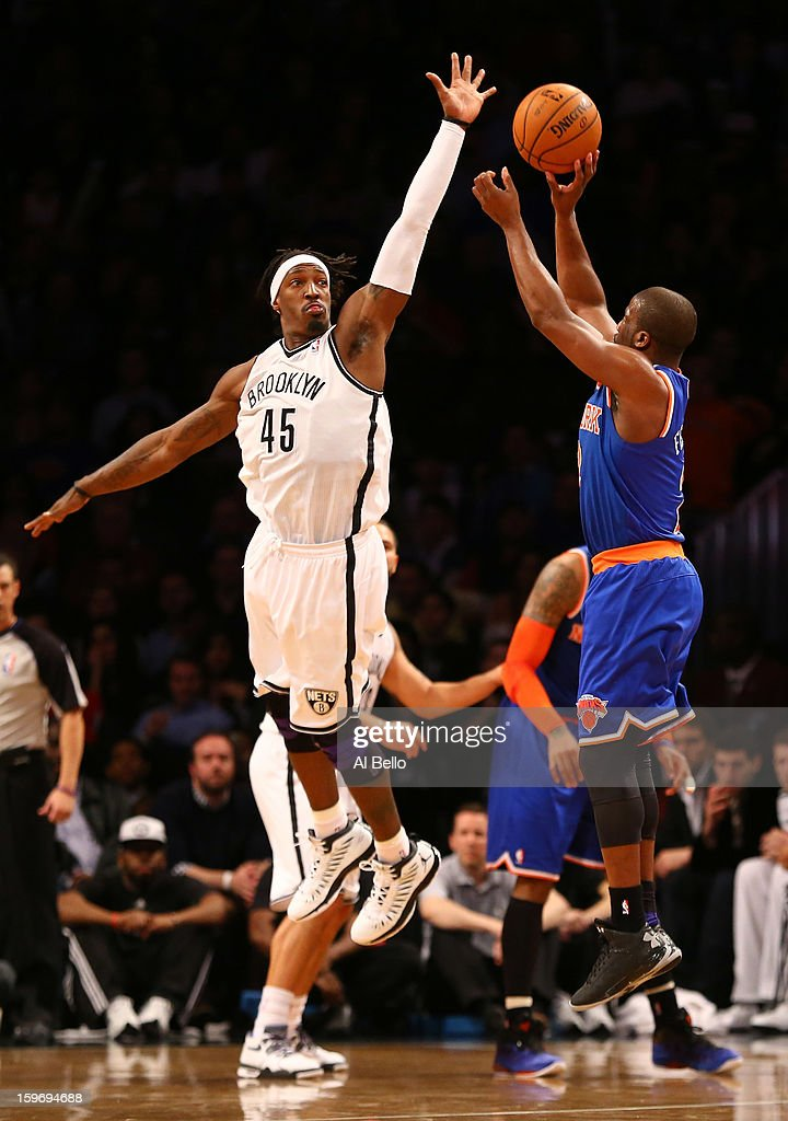 Raymond Felton #2 of the New York Knicks shoots against Gerald Wallace #45 of the Brooklyn Nets during their game at the Barclays Center on December 11, 2012 in the Brooklyn borough of New York City.