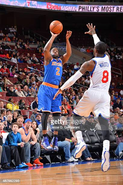 Raymond Felton of the New York Knicks shoots against Tony Wroten of the Philadelphia 76ers at the Wells Fargo Center on March 21 2014 in Philadelphia...
