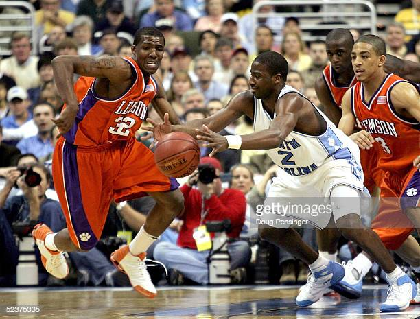 Raymond Felton of the North Carolina Tar Heels grabs a loose ball in front of Sam Perry of the Clemson Tigers during their second round ACC...