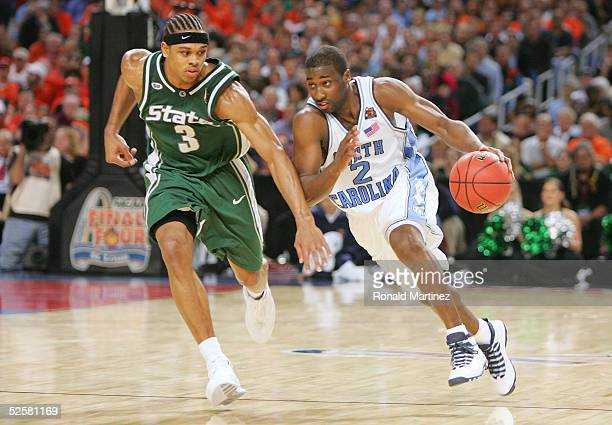 Raymond Felton of the North Carolina Tar Heels runs hard up the court against Shannon Brown of the Michigan State Spartans during the second half of...