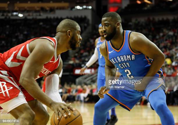 Raymond Felton of the Oklahoma City Thunder guards Chris Paul of the Houston Rockets in the first half at Toyota Center on April 7 2018 in Houston...