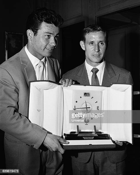 Raymond Kopa receives an award for his contribution with the national team during the 1958 FIFA World Cup. Just Fontaine.