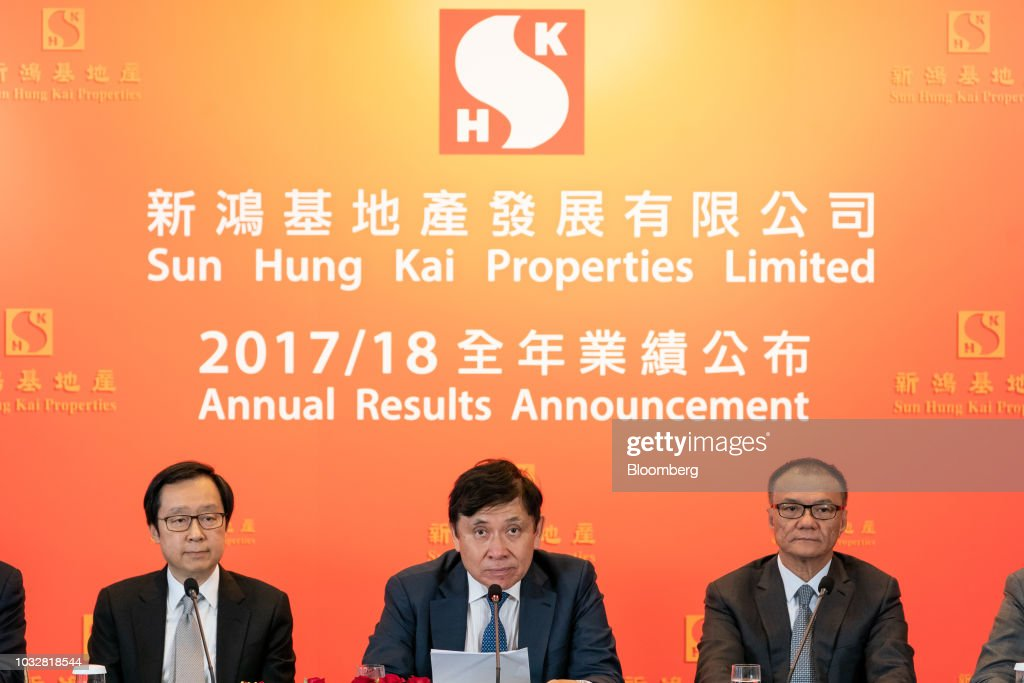 Raymond Kwok, chairman of Sun Hung Kai Properties Ltd., center, speaks alongside Victor Lui deputy managing director of Sun Kong Kai Ltd., left, and Mike Wong, deputy managing director of Sun Jung Kai Properties Ltd., during a news conference in Hong Kong, China, on Thursday, Sept. 13, 2018. Sun Hung Kai, Hong Kong's biggest developer, reported a 17 percent rise in annual earnings as the city's residential market maintained its upward momentum. Photographer: Anthony Kwan/Bloomberg via Getty Images