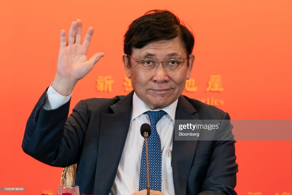 Raymond Kwok, chairman of Sun Hung Kai Properties Ltd., gestures during a news conference in Hong Kong, China, on Thursday, Sept. 13, 2018. Sun Hung Kai, Hong Kong's biggest developer, reported a 17 percent rise in annual earnings as the city's residential market maintained its upward momentum. Photographer: Anthony Kwan/Bloomberg via Getty Images