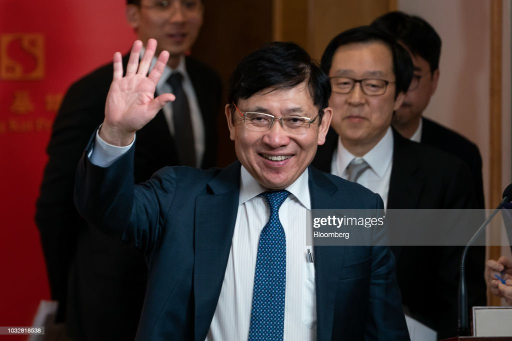 Raymond Kwok, chairman of Sun Hung Kai Properties Ltd., waves as he departs a news conference in Hong Kong, China, on Thursday, Sept. 13, 2018. Sun Hung Kai, Hong Kong's biggest developer, reported a 17 percent rise in annual earnings as the city's residential market maintained its upward momentum. Photographer: Anthony Kwan/Bloomberg via Getty Images