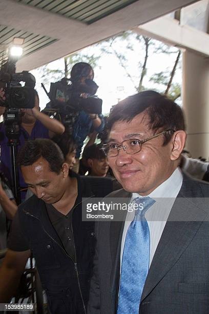 Raymond Kwok cochairman of Sun Hung Kai Properties Ltd arrives at the Eastern Magistrates' Court in Hong Kong China on Friday Oct 12 2012 Sun Hung...