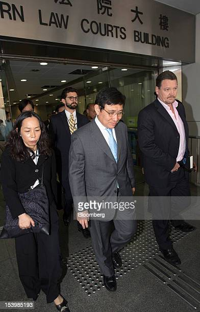 Raymond Kwok cochairman of Sun Hung Kai Properties Ltd center exits the Eastern Magistrates' Court in Hong Kong China on Friday Oct 12 2012 Sun Hung...