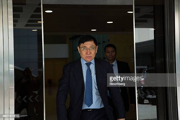 Raymond Kwok cochairman of Sun Hung Kai Properties Ltd leaves the High Court in Hong Kong China on Tuesday Dec 9 2014 The case is Hong Kong Special...