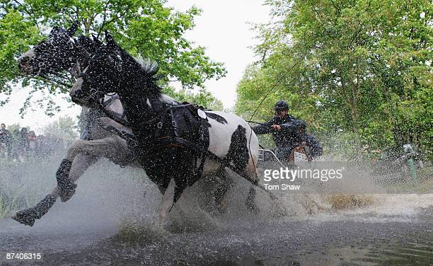 Raymond Letteboer of Netherlands goes through the water obstacle during the Land Rover International Driving Grand Prix at the Royal Windsor Horse...