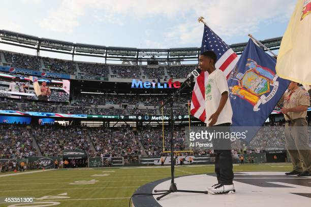 Raymond Luke Jr of the Broadway show Motown The Musical performs the National Anthem before the Indianapolis Colts vs New York Jets game at MetLife...