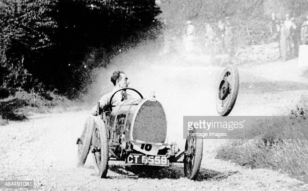 Raymond Mays' Bugatti loses a wheel Mays looks remarkably calm as a wheel flies off the left side of his car Mays was a racing driver of the prewar...