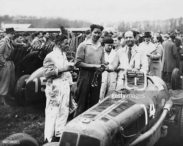 Raymond Mays of Great Britain and driver of the ERA CType is congratulated by third placed Peter Whitehead and second placed Percival Maclure after...