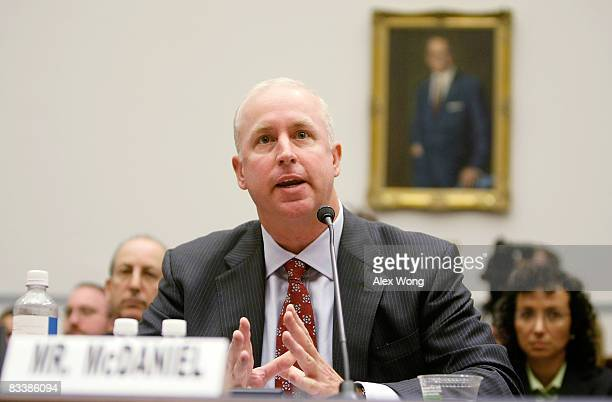 Raymond McDaniel chairman and CEO of Moody's Corporatio testifies during a hearing before the House Oversight and Government Reform Committee on...