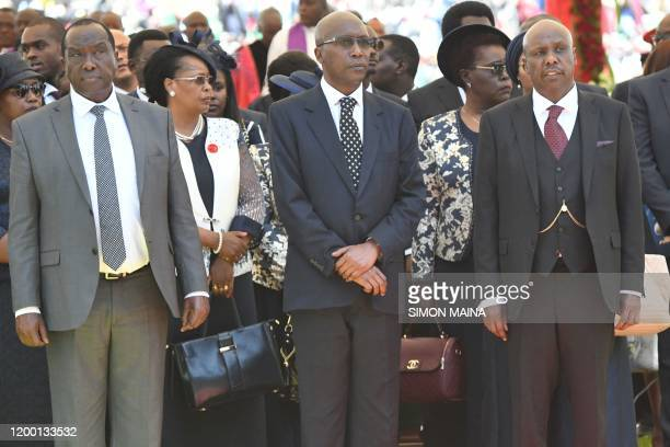 Raymond Moi Philip Moi and Gideon Moi stand with family members during a funeral service of their father late former Kenya President Daniel Arap Moi...