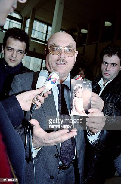 Raymond Nakachian a wealthy Lebanese businessman and husband of Korean singer Kimera holds the picture of their fiveyearold daughter Melodie...