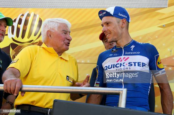 Raymond Poulidor chats with Philippe Gilbert of Belgium and Quick Step Floors who received the award for stages best fighter following stage 16 of Le...