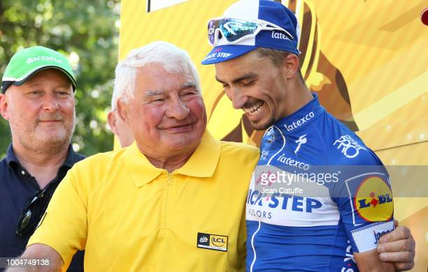 Raymond Poulidor congratulates on the podium Julian Alaphilippe of France and Quick Step Floors for winning stage 16 of Le Tour de France 2018...