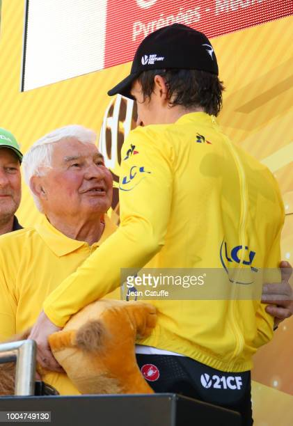 Raymond Poulidor greets leader's yellow jersey Geraint Thomas of Great Britain and Team Sky following stage 16 of Le Tour de France 2018 between...