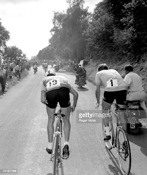 Raymond Poulidor left and Jacques Anquetil riding the PuydeDme stage during the 1964 Tour de France