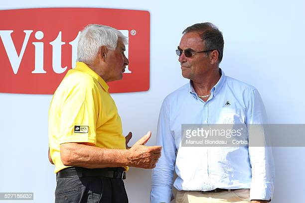 Raymond Poulidor of France and Bernard Hinault of France are pictured on the podium during the 2015 Tour of France Stage 14 Rodez Mende on July 18...