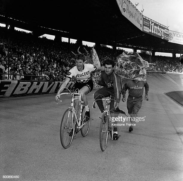 Raymond Poulidor winner of the Grand Prix des Nations cycling race and Ferdinand Bracke is 2nd at the arrival on September 15 1963 in Paris France
