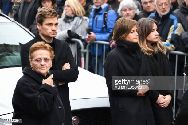 Raymond Poulidor's widow Gisele Poulidor Poulidor's grandson Dutch cyclist David van der Poel and Poulidor's daughter Corinne attend the funerals of...