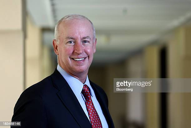 Raymond 'Ray' McDaniel chief executive officer of Moody's Corp poses for a photograph at the AsiaPacific Economic Cooperation CEO Summit in Nusa Dua...
