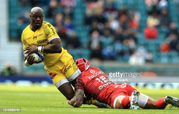 Raymond Rhule of La Rochelle is tackled by Pita Ahki during the Heineken Champions Cup Final match between La Rochelle and Toulouse at Twickenham...