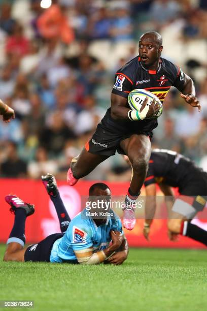 Raymond Rhule of the Stormers jumps to evade the tackle of Kurtley Beale of the Waratahs during the round two Super Rugby match between the Waratahs...