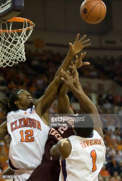 Raymond Sykes of the Clemson Tigers blocks this shot of Dorenzo Hudson of the Virginia Tech Hokies at Littlejohn Coliseum March 9 2008 in Clemson...