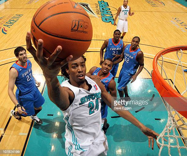 Raymond Sykes of the Sioux Falls Skyforce lays the ball up past four players of the Tulsa 66ers in the second half of their game December 10 2010 at...