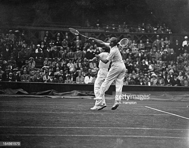 Raymond Tuckey and Frank Wilde of Great Britain in action during their Davis Cup Challenge Round doubles match against Don Budge and Gene Mako of the...