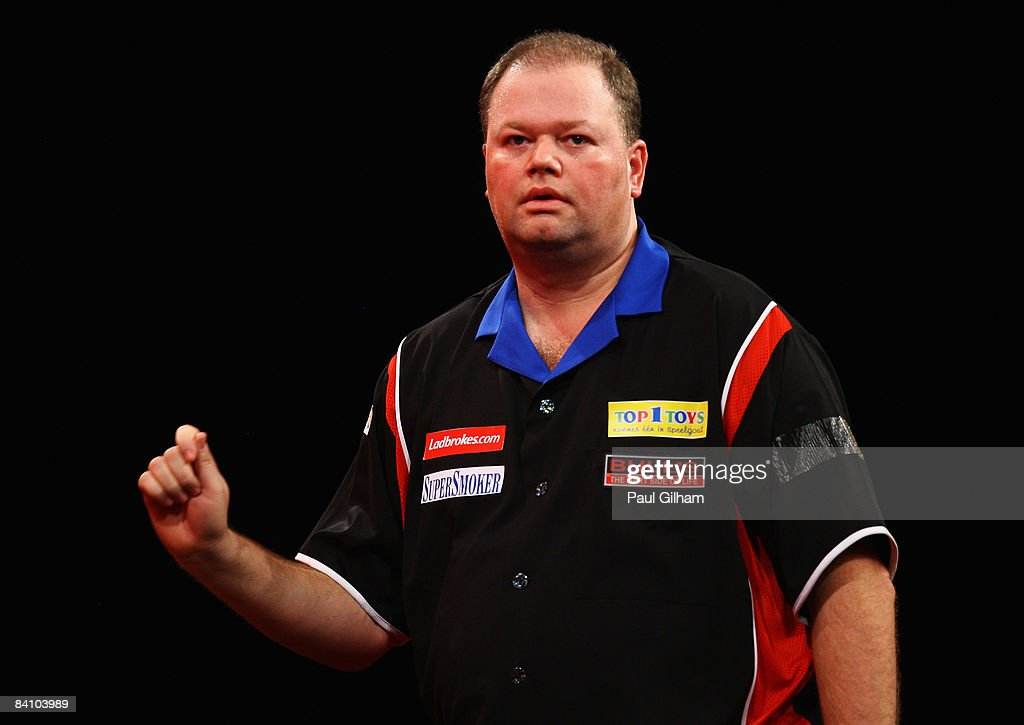 Raymond van Barneveld celebrates winning the first round match between Raymond van Barneveld of Netherlands and Mark Stephenson of England during the 2009 Ladbrokes.com PDC World Darts Championship at Alexandra Palace on December 21, 2008 in London, England.