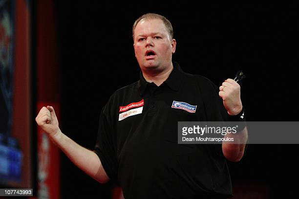 Raymond van Barneveld of Holland celebrates his win against Steve Hine of England during day 7 in the 2011 Ladbrokescom World Darts Championship at...