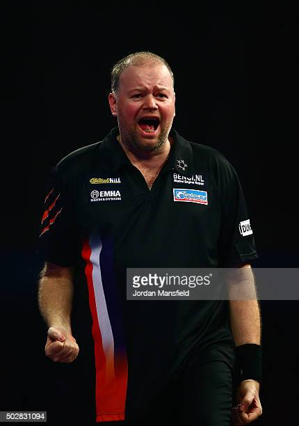 Raymond van Barneveld of Holland celebrates victory in his third round match against Michael van Gerwen of Holland on Day Eleven of the 2016 William...