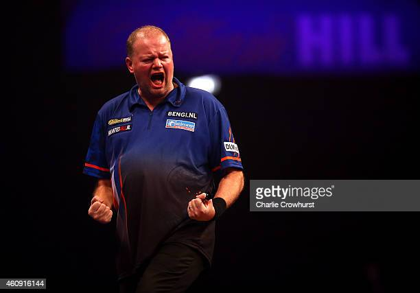 Raymond van Barneveld of Holland celebrates winning a set during his third round match against Adrian Lewis of England during the William Hill PDC...
