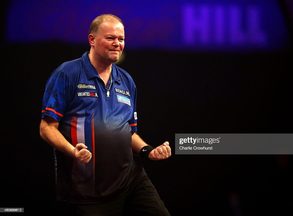 Raymond van Barneveld of Holland celebrates winning his Second round match against Jamie Caven of England during the William Hill PDC World Darts Championships on Day Nine at Alexandra Palace on December 29, 2014 in London, England.