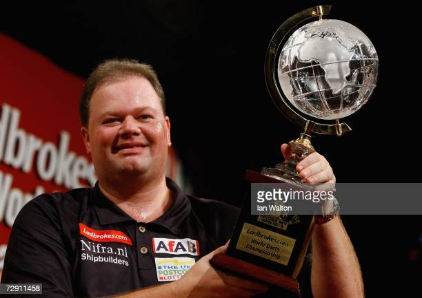 Raymond Van Barneveld of Holland celebrates winning the finals of the Ladbrokes World Darts Championship at The Circus Tavern on January 1 2007 in...
