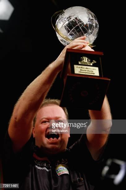 Raymond Van Barneveld of Holland celebrates winning the finals of the Ladbrokes World Darts Championship at The Circus Tavern on January 1, 2007 in...