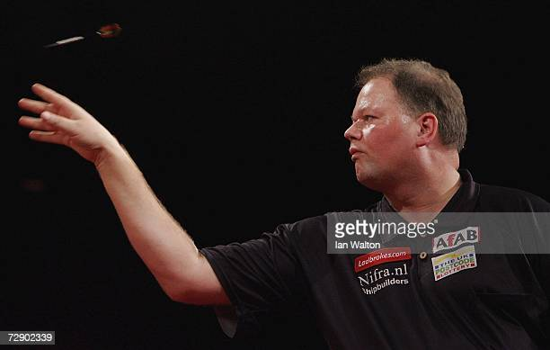 Raymond Van Barneveld of Holland in action against Alan Tabern of England during the quarter-finals of the Ladbrokes World Darts Championship at The...