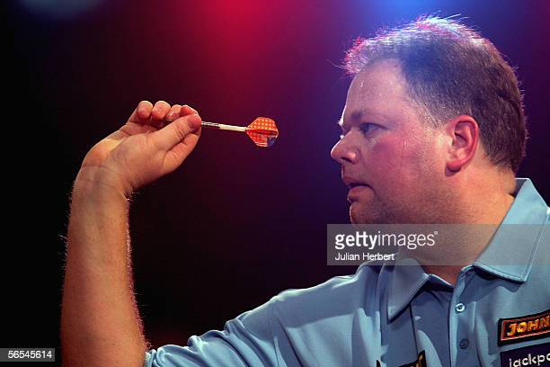 Raymond Van Barneveld of Holland in action against Brian Sorensen of Denmark during the BDO World Darts Championships at the Lakeside on January 9...