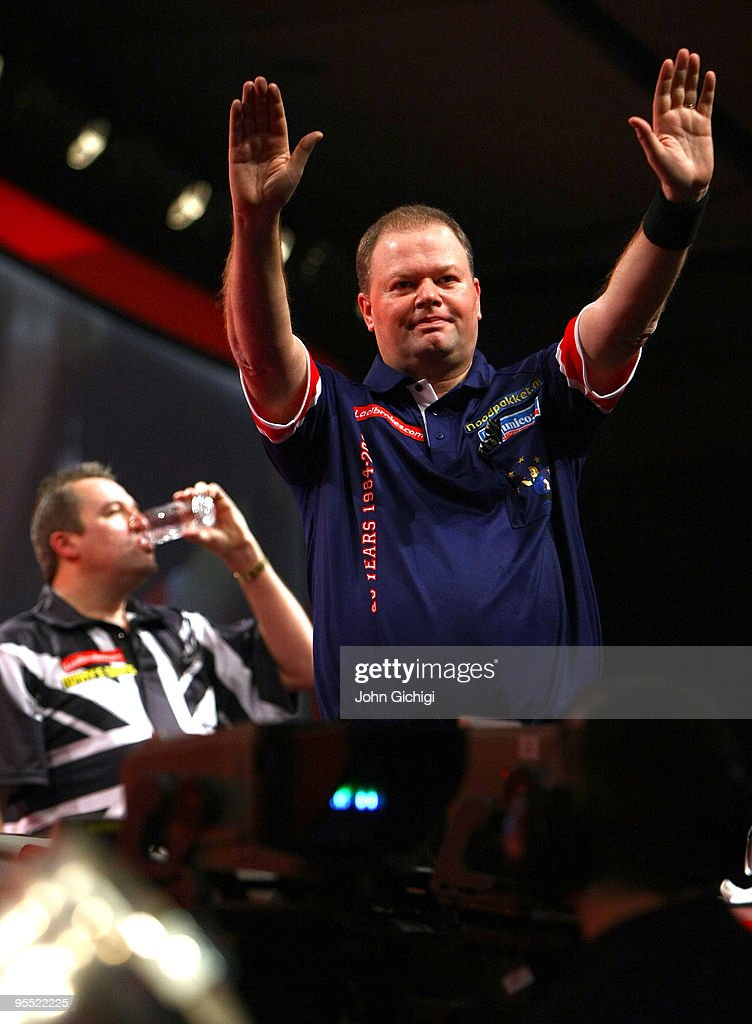 Raymond Van Barneveld of Netherlands celebrates after beating Ronnie Baxter of England during the Quarter Finals of the 2010 Ladbrokes.com World Darts Championships at Alexandra Palace on January 1, 2010 in London, England.