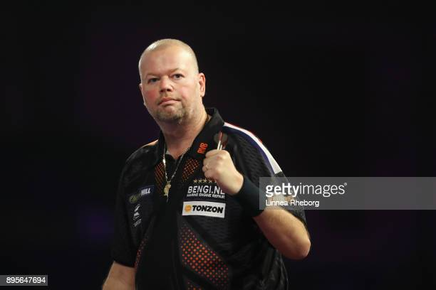 Raymond van Barneveld of Netherlands celebrates after winning his first round match against Richard North of England on day six of the 2018 William...