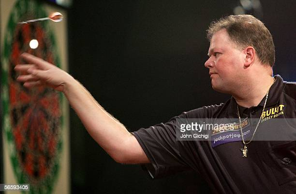 Raymond Van Barneveld of Netherlands throws against Martin Adams of England during the semi finals of BDO World Darts Championships on January 14...