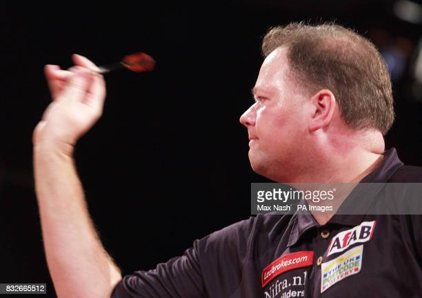 Raymond van Barneveld of the Netherlands against England's Andy Jenkins during the semifinal of the PDC Ladbrokescom World Championships at Purfleet...