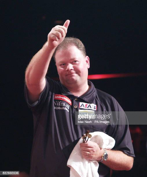 Raymond van Barneveld of the Netherlands celebrates winning 60 his semifinal against England's Andy Jenkins in the World Darts Championship at...