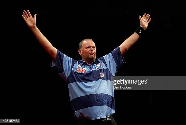 Raymond van Barneveld of the Netherlands celebrates winning the McCoys Premier League Darts PlayOffs Final match between Raymond van Barneveld and...