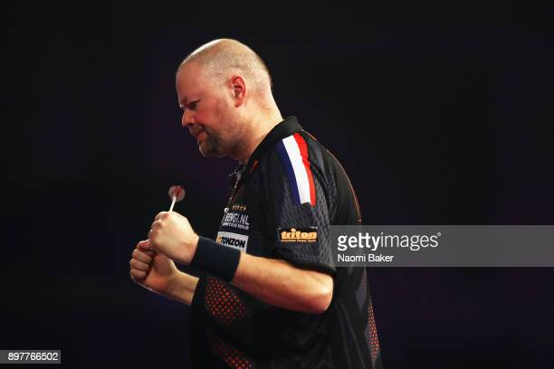 Raymond van Barneveld of the Netherlands celerates after winning the second round match against Kyle Anderson of Austria on day ten of the 2018...