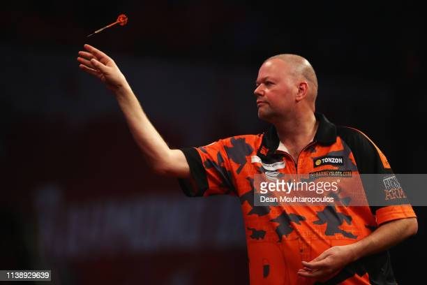 Raymond van Barneveld of the Netherlands competes against Michael van Gerwen of the Netherlands during day two of the 2019 Unibet Premier League...