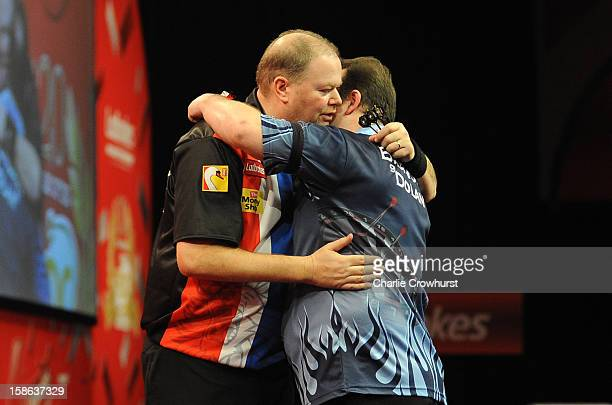 Raymond van Barneveld of the Netherlands congratulates Brendan Dolan of Northern Ireland during his second round match on day nine of the...